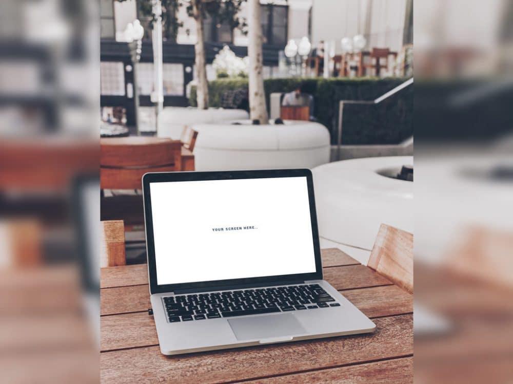 MacBook in Street Café Mockup
