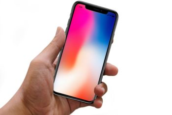 Male Hand holding iPhone X Free Mockup