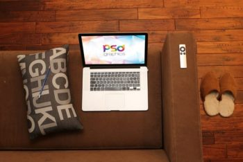 Free MacBook Pro Plus Sofa Mockup