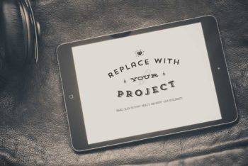 Free iPad Plus Leather Background Mockup
