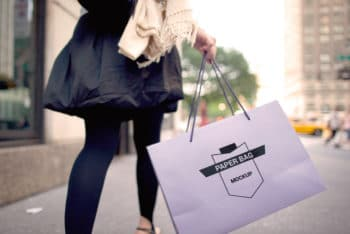 Free Lady Carrying Paper Bag Mockup