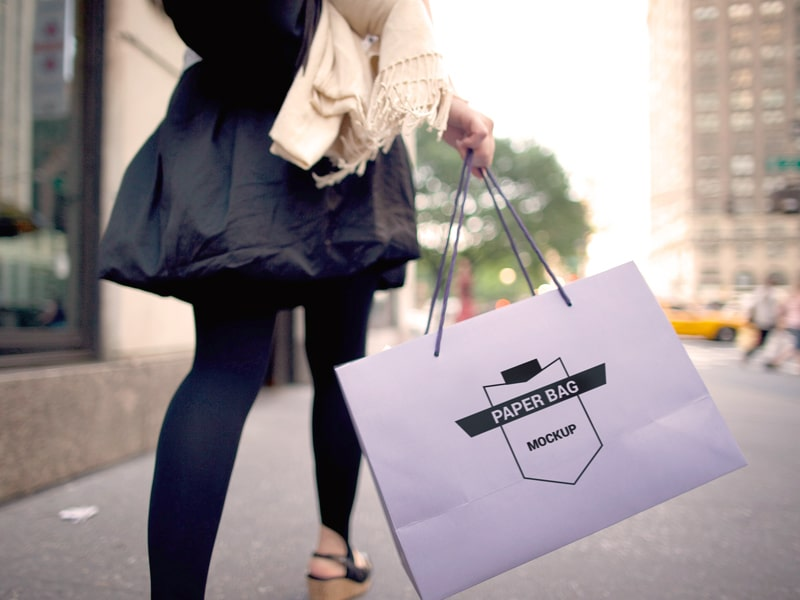 Lady Carrying Paper Bag