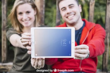 Couple Holding Tablet Mockup Freebie in PSD