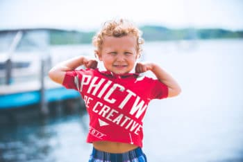 Free Happy Child Wearing Shirt Mockup in PSD