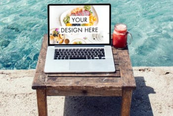 Free MacBook Plus Beach Scene Mockup in PSD