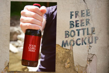 Free Hand Holding Beer Bottle Mockup in PSD