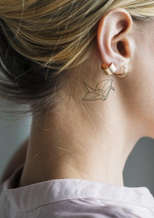 Woman Plus Ear Tattoo