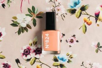 Free Floral Nail Polish Scene Mockup in PSD