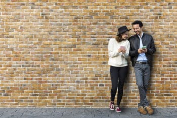 Free Dating Couple Plus Brick Wall Scene Mockup in PSD