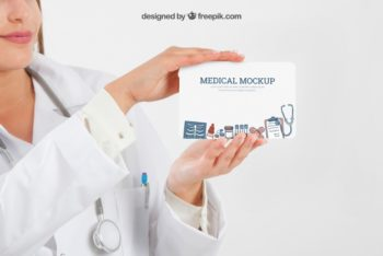 Free Doctor Holding Medical Sign Mockup in PSD