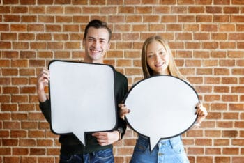 Free Happy Couple Holding Placard Mockup in PSD