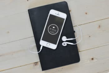 Free iPhone Plus Headphones Scene Mockup in PSD