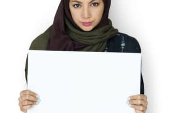 Free Arab Woman Holding Blank Board Mockup