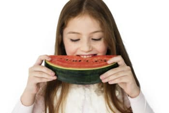 Free Girl Eating Watermelon Mockup in PSD
