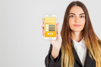 Free Businesswoman Holding Smartphone Mockup