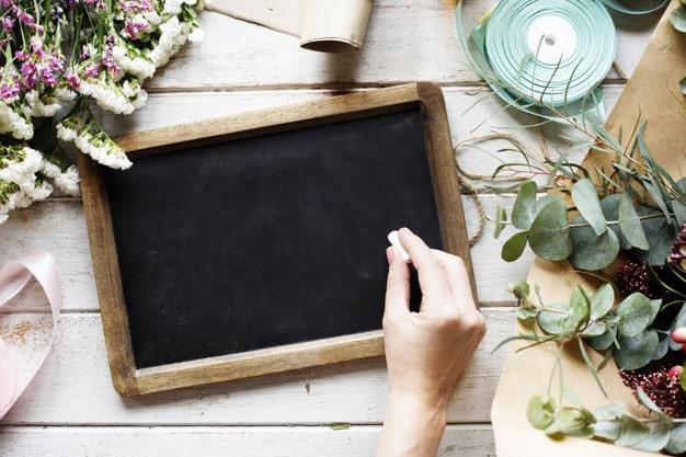 Hand Holding Chalk Plus Slate