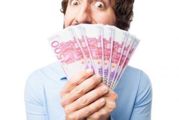 Free Man Holding Many Bills Mockup in PSD
