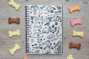 Free Notebook Plus Dog Treats Mockup in PSD