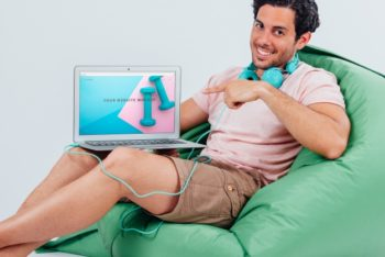 Free Beanbag Sitting Man Plus Laptop Mockup in PSD