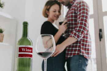 Free Wine Plus Loving Couple Mockup in PSD