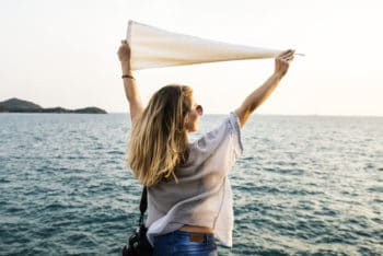 Free Woman Holding Flag Plus Sea Mockup in PSD