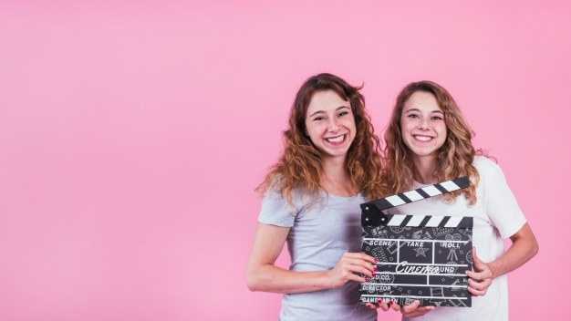 Young Girls Plus Clapperboard