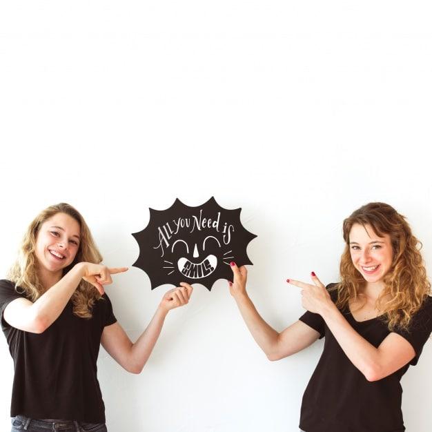 Twin Young Girls Plus Speech Bubble