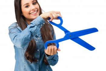 Free Woman Holding Large Scissors Mockup in PSD
