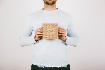 Free Man Holding Small Carton Box Mockup