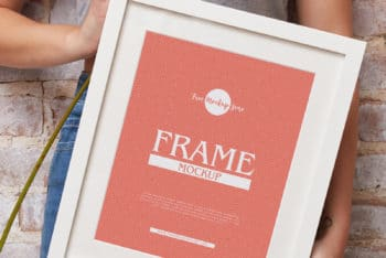 Download Girl Showing Frame PSD Mockup for Photorealistic Presentation